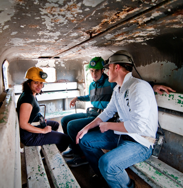 students from the Institute without Boundaries riding a bus at a coal mine in Chile