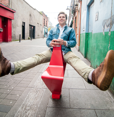 Institute without Boundaries student on a seat prototype for bollards in Dublin, Ireland